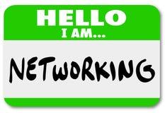 Gente de la reunión de la etiqueta engomada del Nametag del establecimiento de una red que hace conexiones Imagen de archivo
