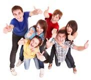 Gente del grupo con los thums para arriba. Imagen de archivo libre de regalías
