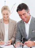 Gente di affari allegra in una riunione Fotografia Stock