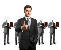 Gente di affari capa della lampada con i computer portatili Fotografia Stock