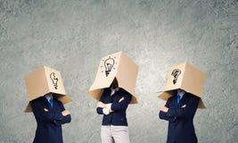 Gente di affari che indossa le scatole Immagini Stock Libere da Diritti