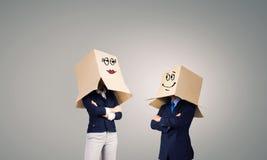 Gente di affari che indossa le scatole Fotografia Stock Libera da Diritti