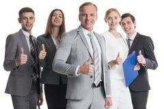 Gente di affari che mostra i pollici in su immagini stock libere da diritti