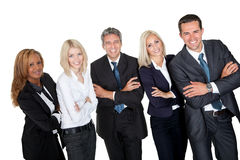 Gente di affari che si leva in piedi con le mani piegate fotografia stock