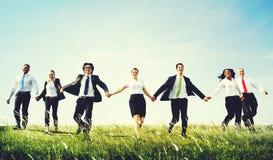 Gente di affari che si siede concetto del vincitore di successo di crescita Immagine Stock