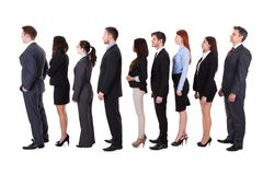 Gente di affari che sta nella coda Immagini Stock