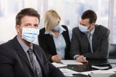 Gente di affari che teme virus h1n1 Fotografia Stock Libera da Diritti