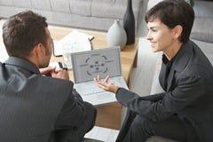 Gente di affari con il computer portatile Fotografie Stock Libere da Diritti