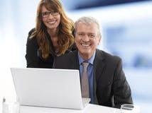 Gente di affari con il computer portatile Immagine Stock Libera da Diritti