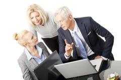 Gente di affari con il computer portatile Fotografia Stock