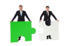 Gente di affari con il puzzle Immagini Stock Libere da Diritti