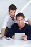 Gente di affari con il ridurre in pani Fotografie Stock