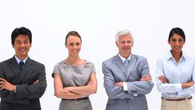 Gente di affari con le armi attraversate Fotografie Stock Libere da Diritti