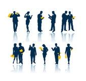 Gente di affari delle siluette illustrazione di stock