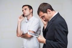 Gente di affari di comunicazione su mezzi mobili Fotografia Stock