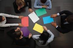Gente di affari e carta di colore Immagine Stock Libera da Diritti