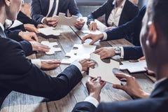 Gente di affari e puzzle Fotografia Stock