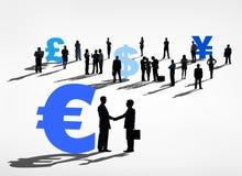 Gente di affari e simboli di valuta Fotografie Stock Libere da Diritti
