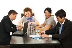 Gente di affari felice alla riunione Immagine Stock