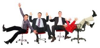 Gente di affari felice sulle presidenze Fotografia Stock Libera da Diritti