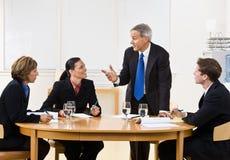 Gente di affari nella riunione Fotografie Stock Libere da Diritti