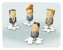 Gente di affari sul puzzle Fotografia Stock