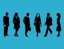 Gente di affari sull'azzurro Immagine Stock