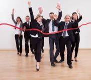 Gente di affari trionfante che celebra Immagine Stock