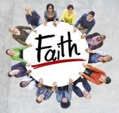 Gente diversa que lleva a cabo concepto de la fe de las manos Imagen de archivo