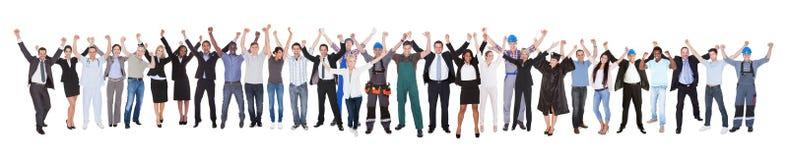 Gente emocionada con diversos empleos que celebra éxito Fotografía de archivo