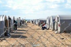 Gente en campamento de refugiados Imágenes de archivo libres de regalías