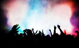 Gente en concierto de la música, disco Foto de archivo