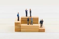 Gente en el bloque de madera Imagen de archivo libre de regalías