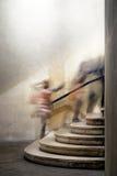 Gente en escalera Imágenes de archivo libres de regalías