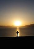 Gente en la salida del sol Imagen de archivo