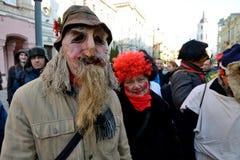 Gente en máscaras tradicionales Imágenes de archivo libres de regalías