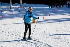 Gente en Ski Field Imagenes de archivo