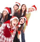 Gente felice del gruppo in cappello della Santa. Fotografia Stock
