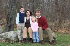 Gente feliz de la familia de cuatro miembros Imágenes de archivo libres de regalías