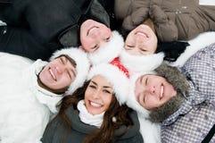 Gente feliz de la juventud del invierno Imagen de archivo libre de regalías