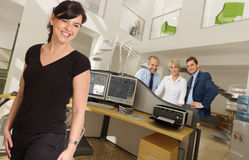Gente feliz en gran oficina Imagen de archivo libre de regalías