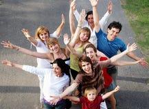 Gente feliz que sonríe en un parque Imágenes de archivo libres de regalías