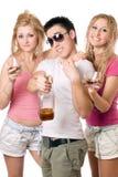 Gente joven alegre con una botella Imagenes de archivo