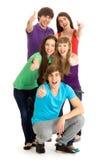 Gente joven con los pulgares para arriba Fotos de archivo libres de regalías