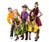 Gente joven del baile en desgaste brillante del color foto de archivo