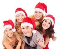 Gente joven del grupo en el sombrero de santa. Imagen de archivo libre de regalías
