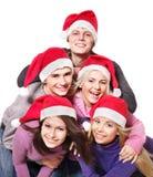 Gente joven del grupo en el sombrero de santa Imagen de archivo