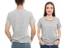 Gente joven en camisetas en blanco Mofa para arriba para el dise?o fotografía de archivo