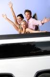 Gente joven que se divierte en limusina Imagen de archivo