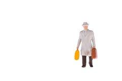Gente miniatura del turista e dell'uomo d'affari Immagine Stock